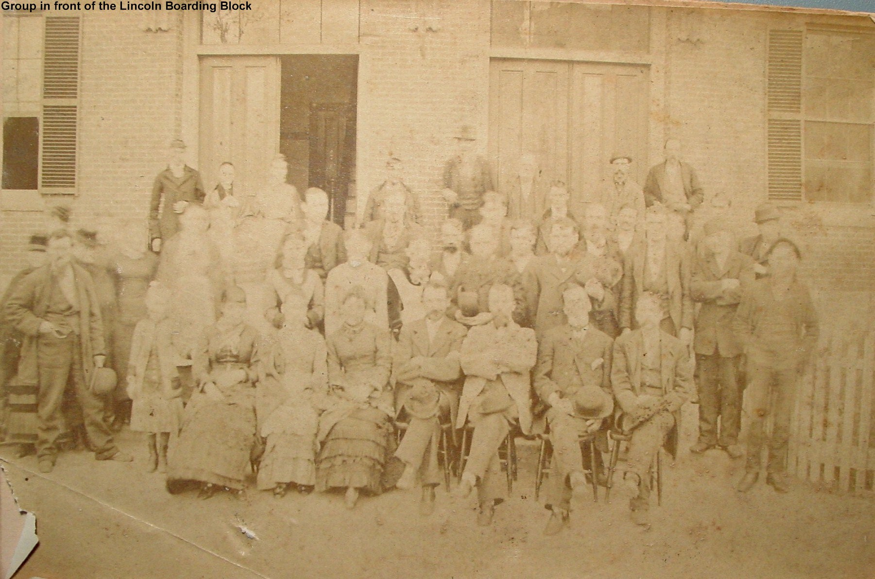 Group in front of Lincoln Boarding Block Lewiston (aka the Littleton Hotel in later years)