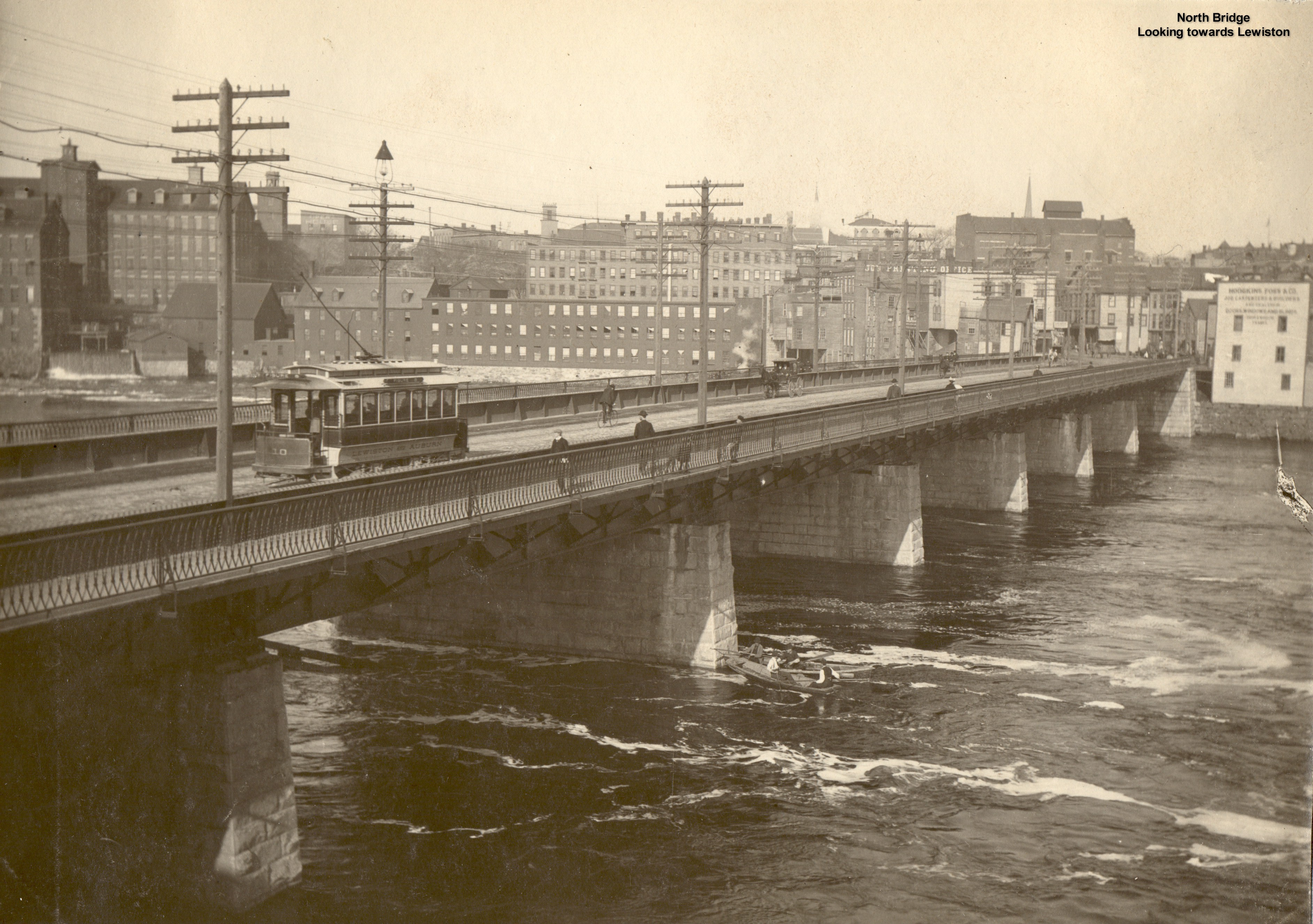 Lewiston/Auburn North Bridge with Trolley and small boat in river