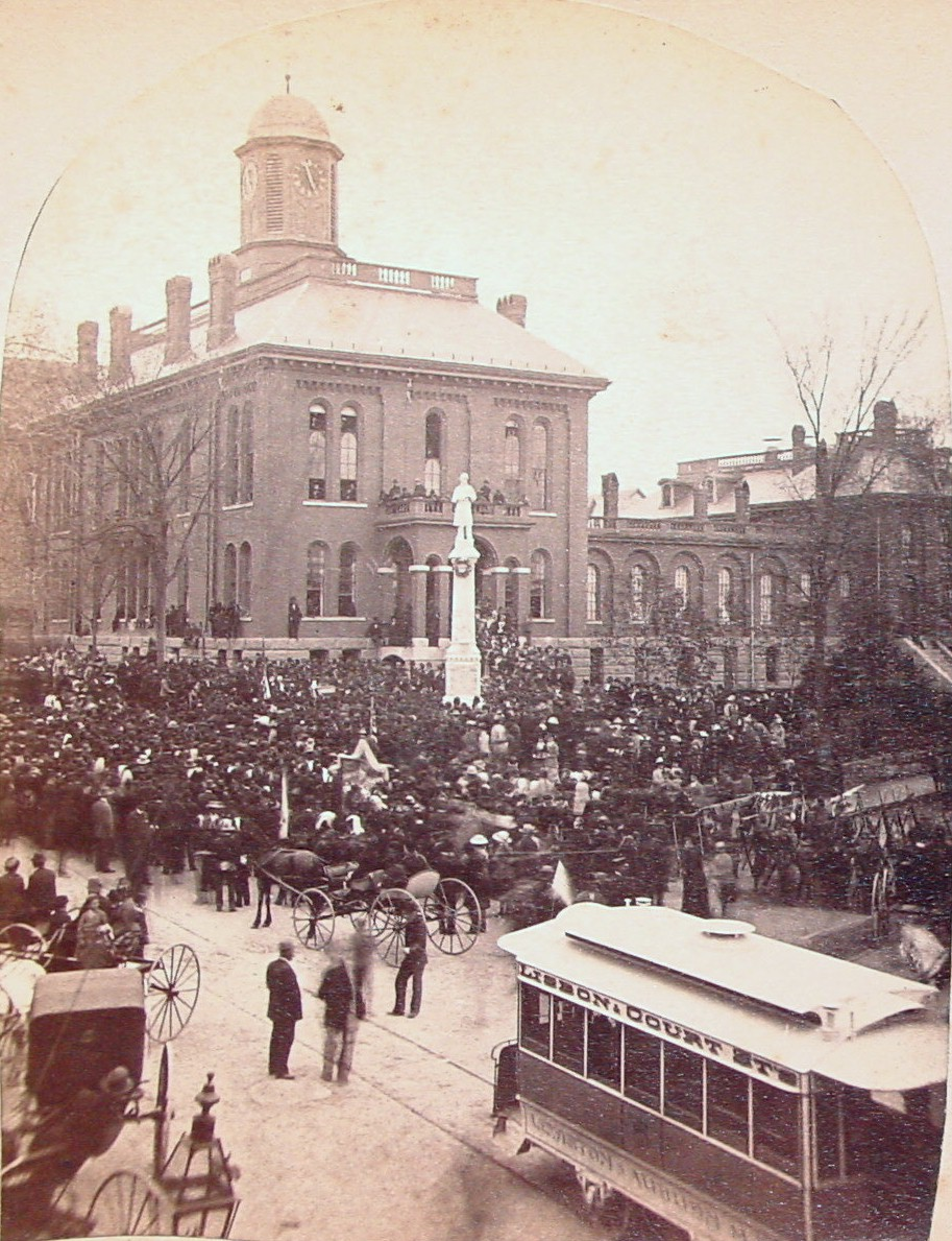 Celebration in front of County courthouse and jail building, Auburn (Shows trolley car)